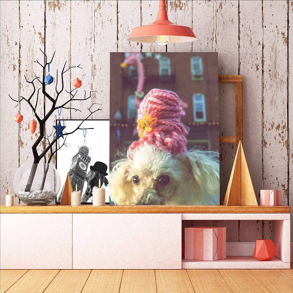 art portrait of a dog wearing a pink hon beehive wig and a dog wearing a bowler cap infront of the bromo seltzer tower in downtown baltimore